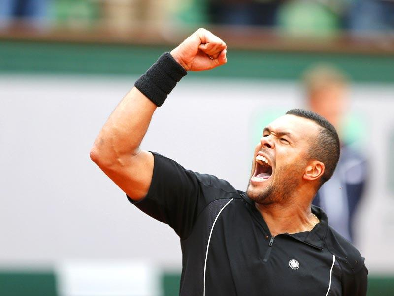 Jo-Wilfried Tsonga of France celebrates after beating Tomas Berdych of the Czech Republic during the men's singles fourth round match at the French Open in Paris. (Reuters Photo)