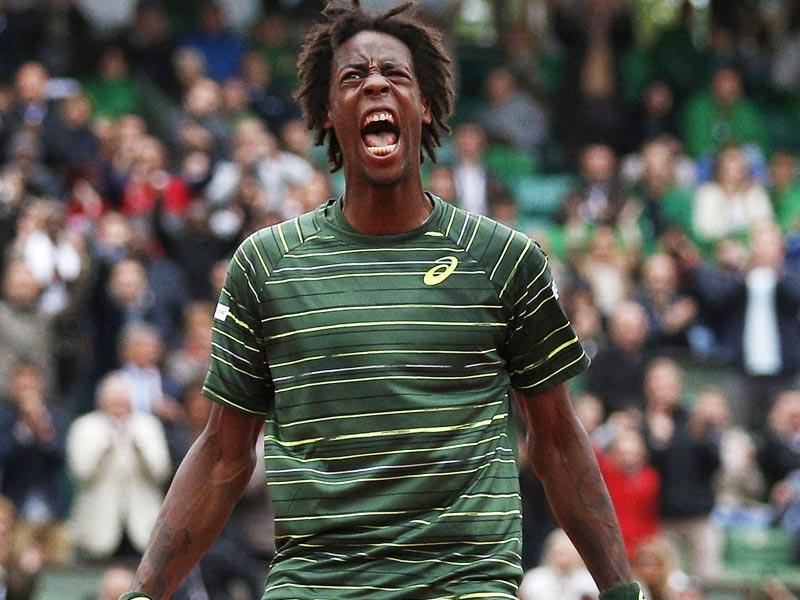 France's Gael Monfils celebrates winning the second set during his men's singles fourth round match against Roger Federer of Switzerland at the French Open in Paris. The match was suspended until Monday due to fading light. (Reuters Photo)
