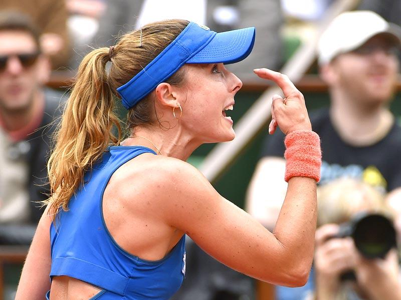 France's Alize Cornet argues with the referee during her match against Ukraine's Elina Svitolina in the women's singles fourth round at the French Open in Paris. (AFP Photo)