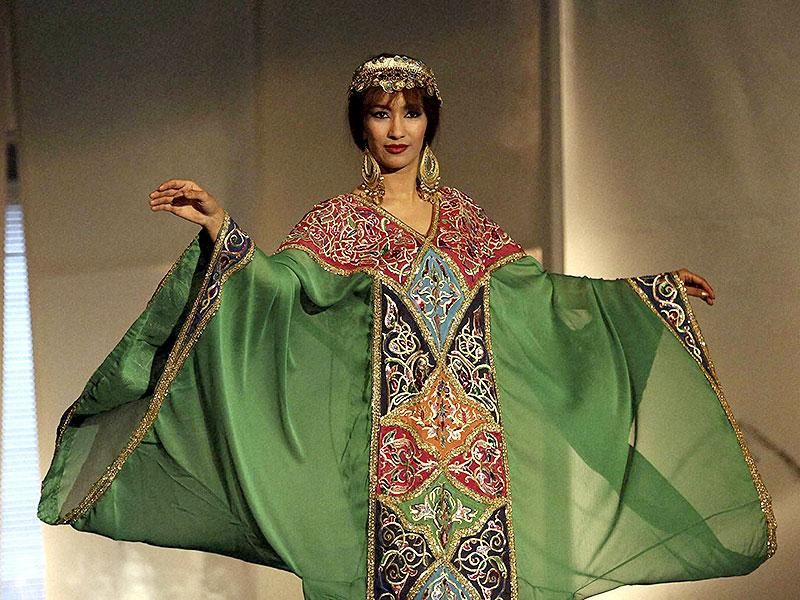 A model displays a multi-fabric creation on the opening day of a folk fashion show event in Baghdad, Iraq on June 1, 2015. (AP)