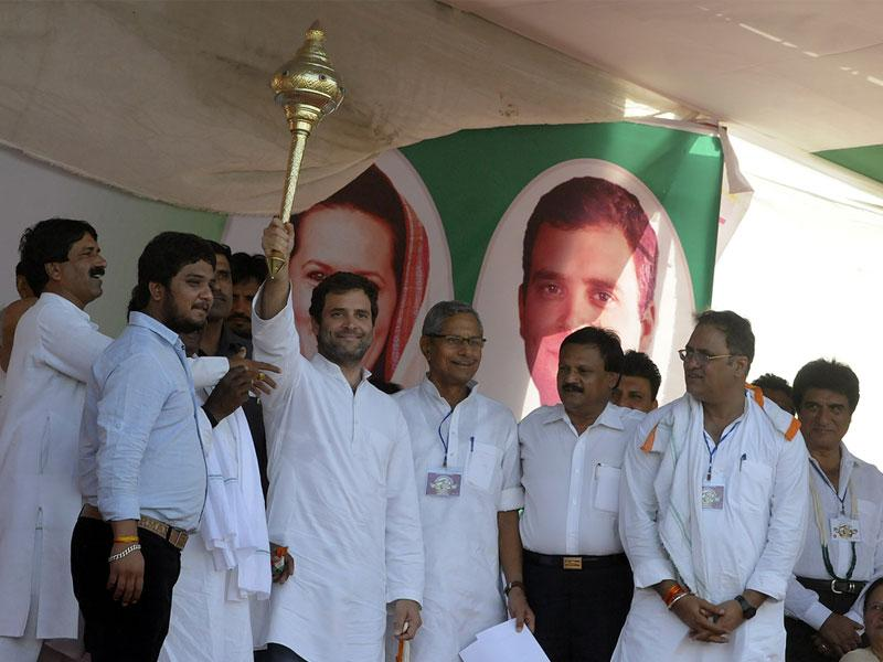 AICC Vice President Rahul Gandhi greets people during the public meeting in Mhow on Tuesday. (Arun Mondhe/HT photo)