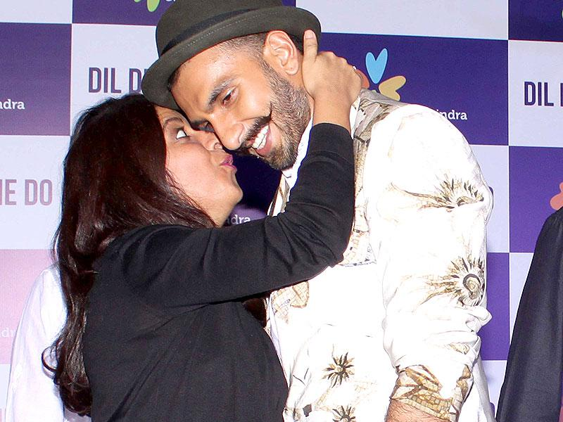 Kisses already! Why not? Isn't everyone praising the movie?Ranveer Singh and filmmaker Zoya Akhtar during the promotion of film Dil Dhadakne Do at a meet and greet event in New Delhi on June 01, 2015. (Photo: IANS)