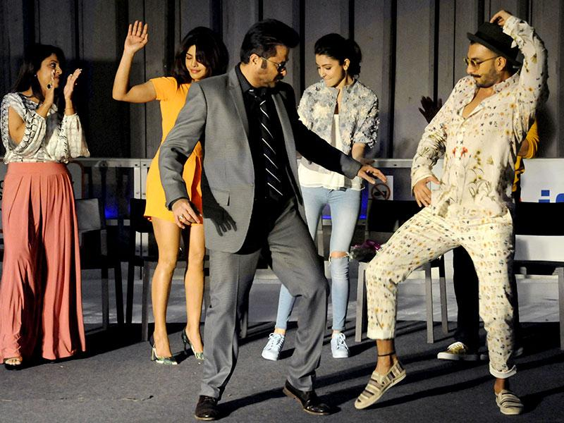 Aren't they playing Yaar Bina Chain Kaha Re? Anil Kapoor and Ranveer Singh have dance during the promotional event of their upcoming movie Dil Dhadakne Do in Ambience mall, in Gurgaon. (Photo by Parveen Kumar/HT)