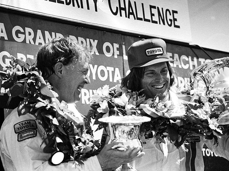 Racer Dan Gurney shares the Winner's Circle with Bruce Jenner (R) at the 1982 Toyota Pro/Celebrity Race at the Long Beach Grand Prix, in Long Beach, California in this April 3, 1982 photo. Jenner is transitioning to life as a woman and recently tweeted,