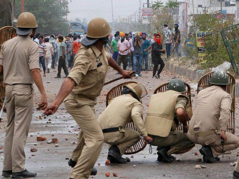 Police personnel in action against Sikh protesters during a clash which broke out after the police removed a poster of Jarnail Singh Bhindranwale in Jammu. Photo courtesy: PTI