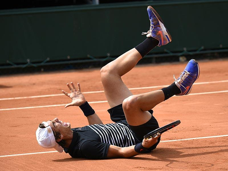 Australia's Thanasi Kokkinakis celebrates after defeating countryman Bernard Tomic during the men's singles second-round match at the 2015 French Open in Paris, France. (AFP Photo)