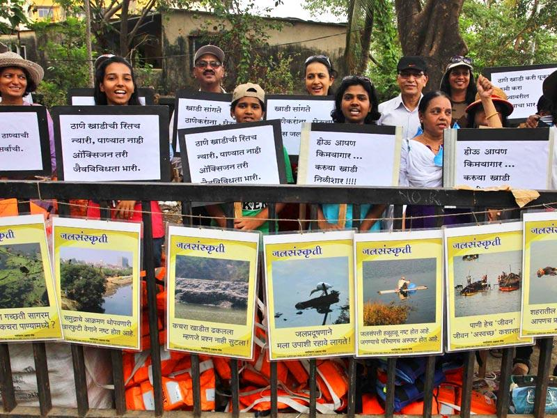 Activists of Paryavaran Dakshata Nanch display placards carrying messages to save the environment on the occasion of World Environment Day, in Thane. (Photo: Praful Gangurde)