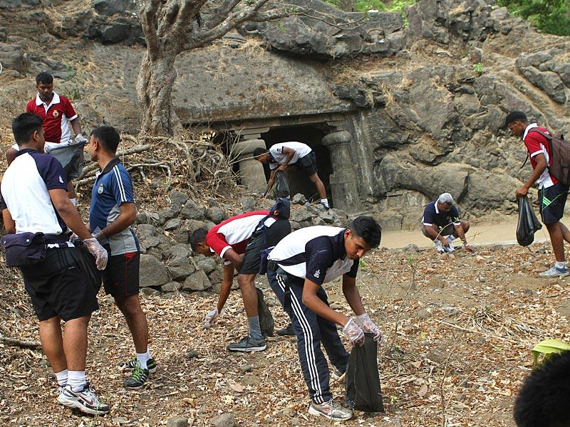 Indian Navy jawans of the Western Naval Command undertook the task of cleaning the famous Elephanta island as part of World Environment Day celebrations, in Mumbai. (Arijit Sen/HT photo)
