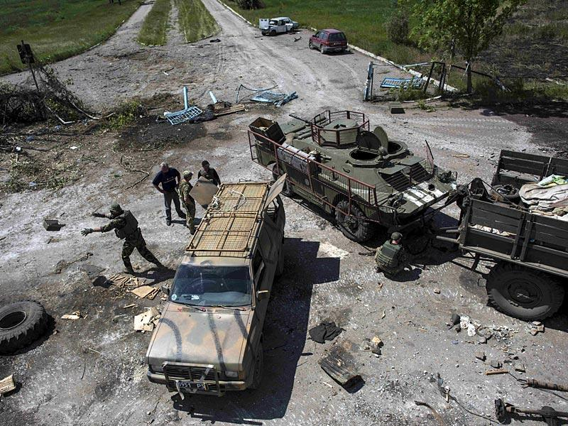 Ukrainian soldiers repair armed vehicles near the division line with separatists in Marinka. (AP Photo)