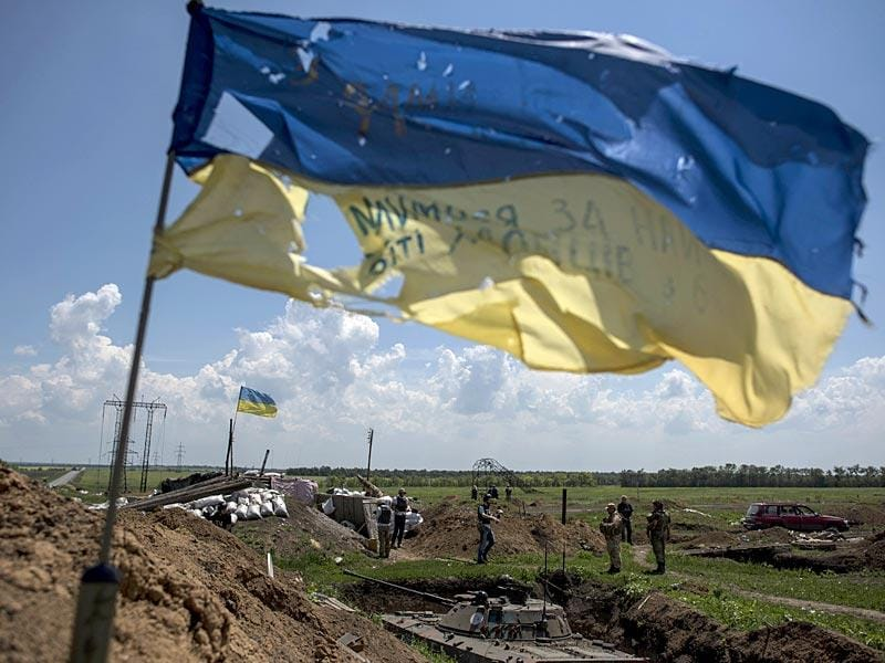 A Ukrainian flag flutters at the Ukrainian position in Marinka. (AP Photo)