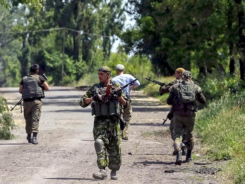 Members of the Ukrainian armed forces patrol an area in the town of Maryinka. (Reuters)