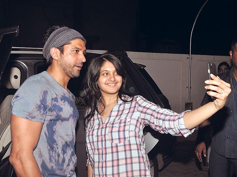 Farhan Akhtar poses for a selfie with a fan in Mumbai. (Photo: Yogen Shah)