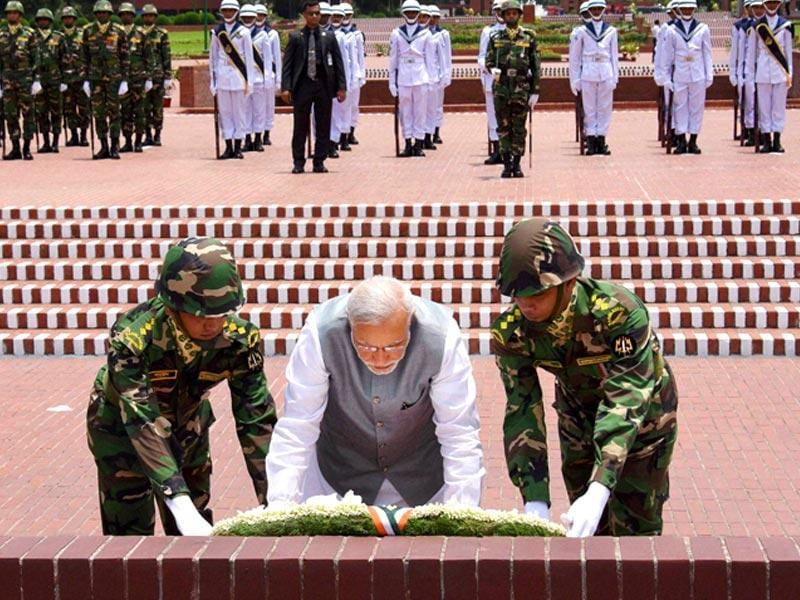 Prime Minister Narendra Modi lays a wreath at National Martyrs' Memorial in Dhaka. PTI Photo