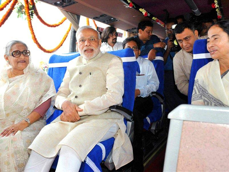Prime Minister Narendra Modi, his Bangladeshi counterpart Sheikh Hasina and West Bengal chief minister Mamata Banerjee sitting in a bus at the flag off ceremony of bus services between Bangladesh and India, in Dhaka . PTI Photo