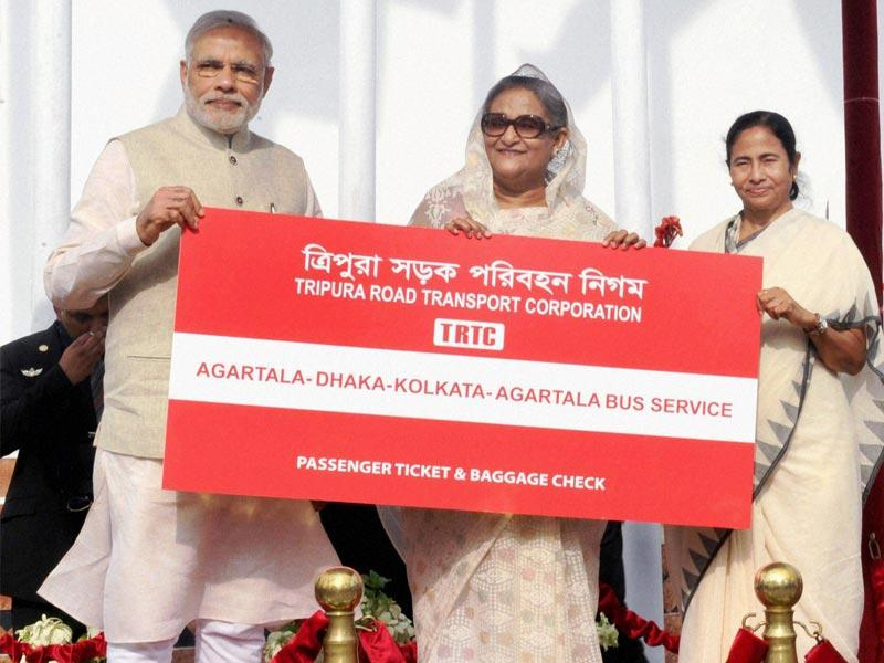 Prime Minister Narendra Modi, his Bangladeshi counterpart Sheikh Hasina and West Bengal chief minister Mamata Banerjee flagging off the Kolkata-Dhaka-Agartala bus service, in Dhaka . PTI Photo