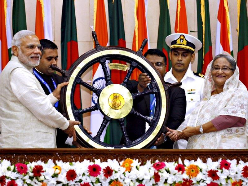 Prime Minister Narendra Modi presents a ship's wheel to Bangladesh's Prime Minister Sheikh Hasina in Dhaka. REUTERS