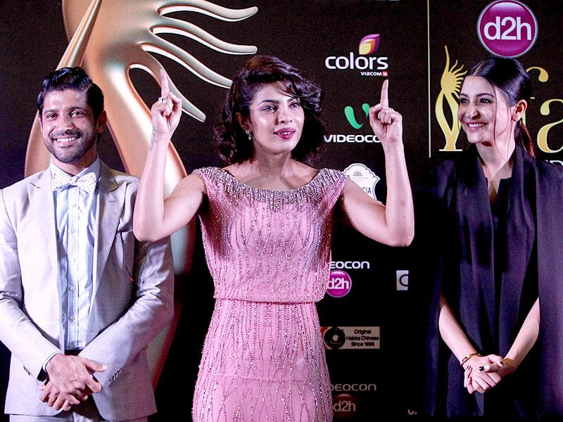 Bollywood actors, from left to right, Farhan Akhtar, Priyanka Chopra, and Anushka Sharma arrive for the IIFA Gala Screening as part of the three-day long International Indian Film Academy (IIFA) awards held in Kuala Lumpur. (AP Photo)