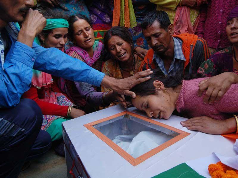 Family members of martyr Vikas bhardwaj wail near his body during his funeral at his native village Patoon Pandol Ladbhrol in district Mandi on Sunday. Birbal Sharma/HT