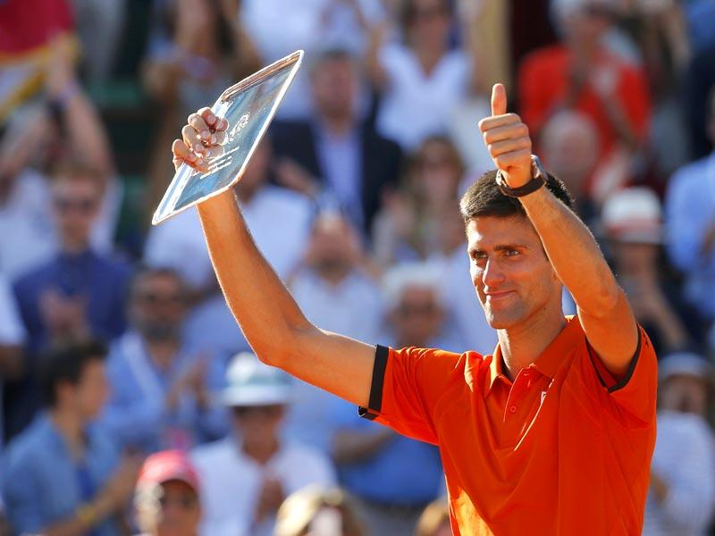 Novak Djokovic of Serbia poses with the runners-up trophy during the presentation ceremony after being defeated by Stan Wawrinka of Switzerland in the men's singles final of the French Open in Paris, France. (Reuters Photo)