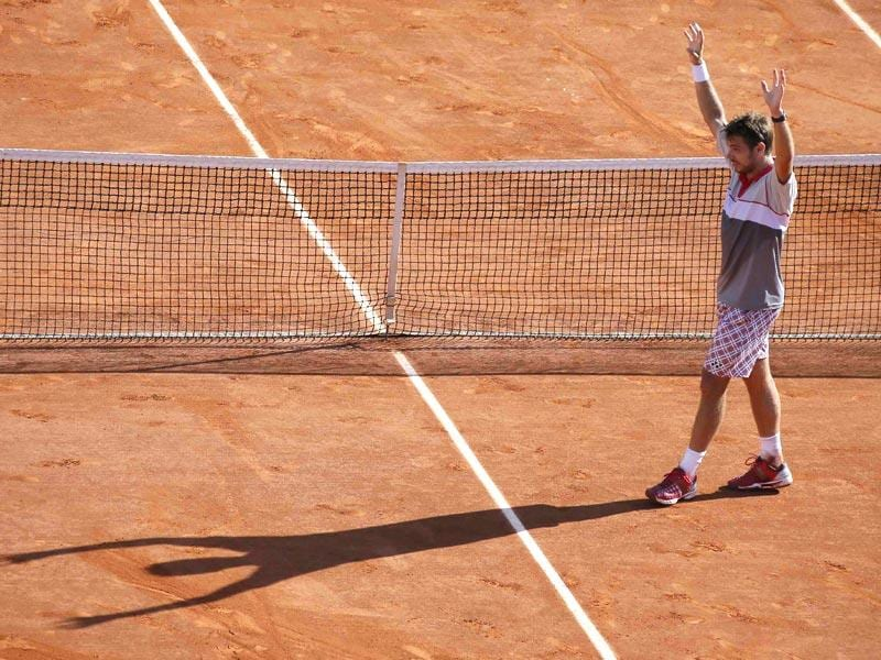Stan Wawrinka of Switzerland celebrates after winning the men's singles final against Novak Djokovic of Serbia during the French Open in Paris, France. (Reuters Photo)