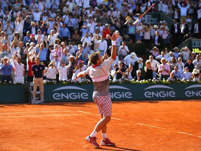 Switzerland's Stan Wawrinka throws his racquet in the air as he celebrates winning the men's final of the French Open in four sets, 4-6, 6-4, 6-3, 6-4, against Serbia's Novak Djokovic, in Paris, France. (AP Photo)