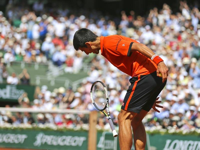 Serbia's Novak Djokovic tries to break his racquet after losing the second set in the men's singles final of the French Open against Switzerland's Stan Wawrinka, in Paris, France. (AP Photo)