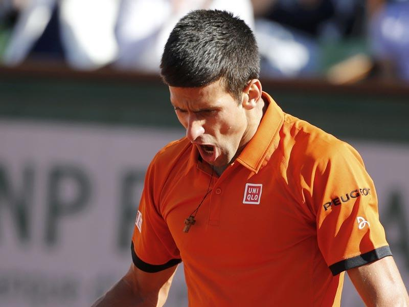Novak Djokovic of Serbia pumps himself up after winning a long rally during the men's singles final match against Stan Wawrinka of Switzerland at the French Open in Paris, France. (Reuters Photo)