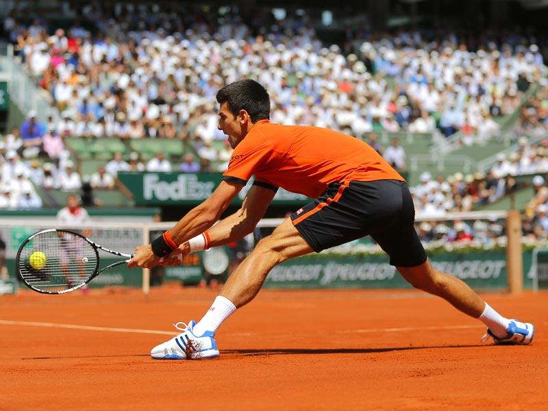 Serbia's Novak Djokovic returns the ball to Switzerland's Stan Wawrinka during the men's singles final of the French Open in Paris, France. (AP Photo)