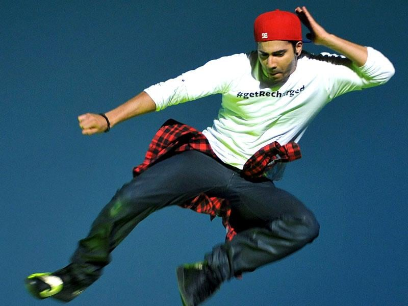 At a promotional event for ABCD 2, Varun Dhawan was in all the mood to have fun and he did his best to defy gravity! (AFP Photo)