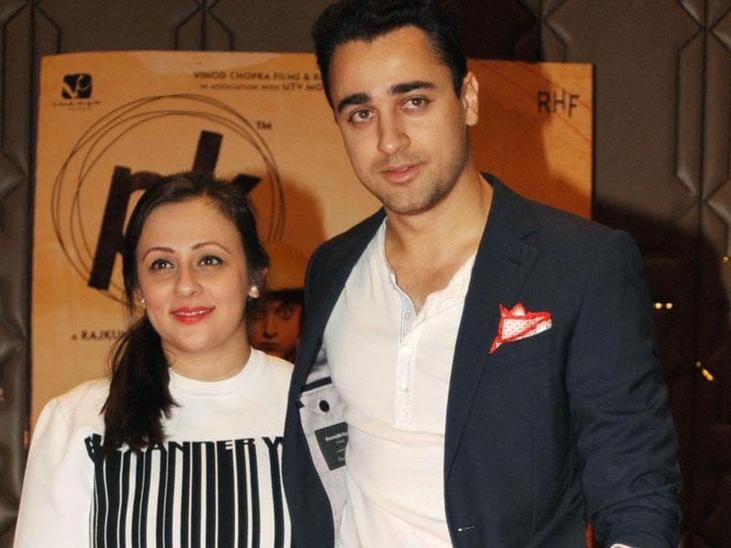 Imran Khan (R) poses for a photograph with his wife during a promotional event for the Hindi film 'PK', directed by Rajkumar Hirani and produced by Hirani and Vidhu Vinod Chopra, in Mumbai on late June 10, 2015. (Photo: AFP)