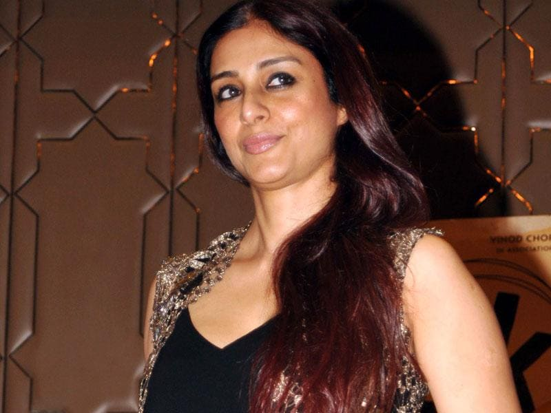 Tabu strikes a pose for the shutterbugs as she arrives at the success bash for PK. (Photo: AFP)