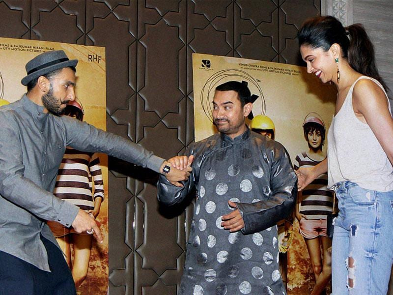 Is Aamir Khan about to officiate at the wedding of Ranveer Singh and Deepika Padukone? Naah, the young actors are just trying to get him to the dance floor...(Photo: PTI)