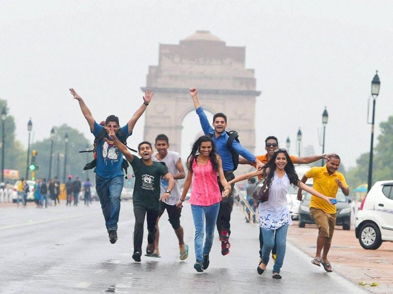 Youngsters enjoying the pre-monsoon showers at India Gate. (PTI Photo)