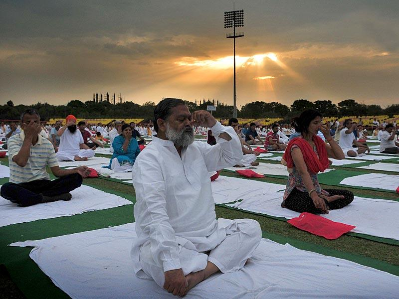 Haryana health minister Anil Vij performing Yoga during a two-day Yoga Prashikshan Shivir organised by Ramdev at Panchkula. (Keshav Singh/HT Photo)