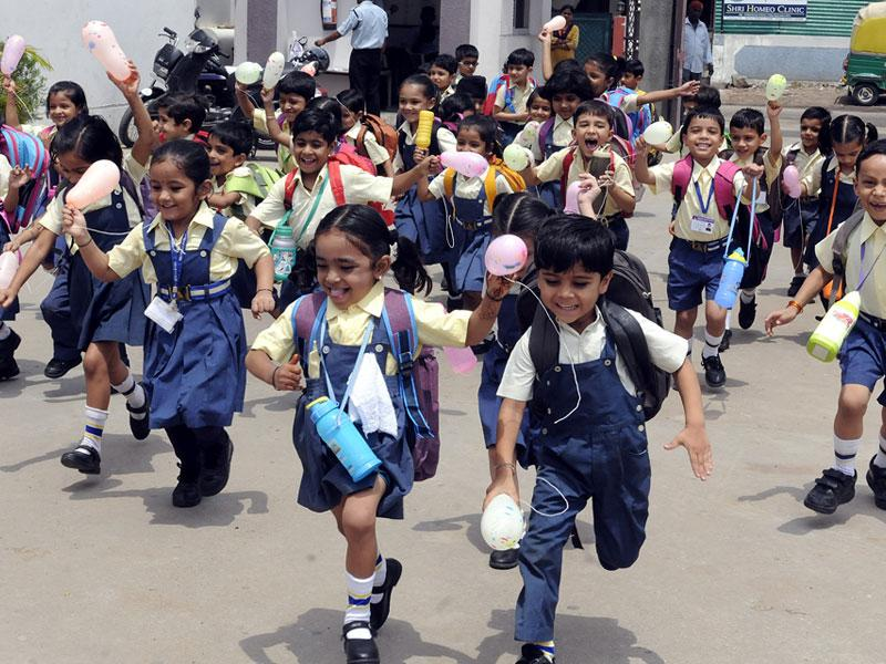Children of Prestige Public School were happy to return to school as new academic session began in Indore on Monday. (Arun Mondhe/HT photo)
