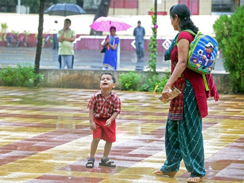 This tiny tot was in tears on the first day of school at Bhayander's Our Lady of Nazareth School and his mom waited for him patiently to stop crying... (Pratham Gokhale/HT photo)