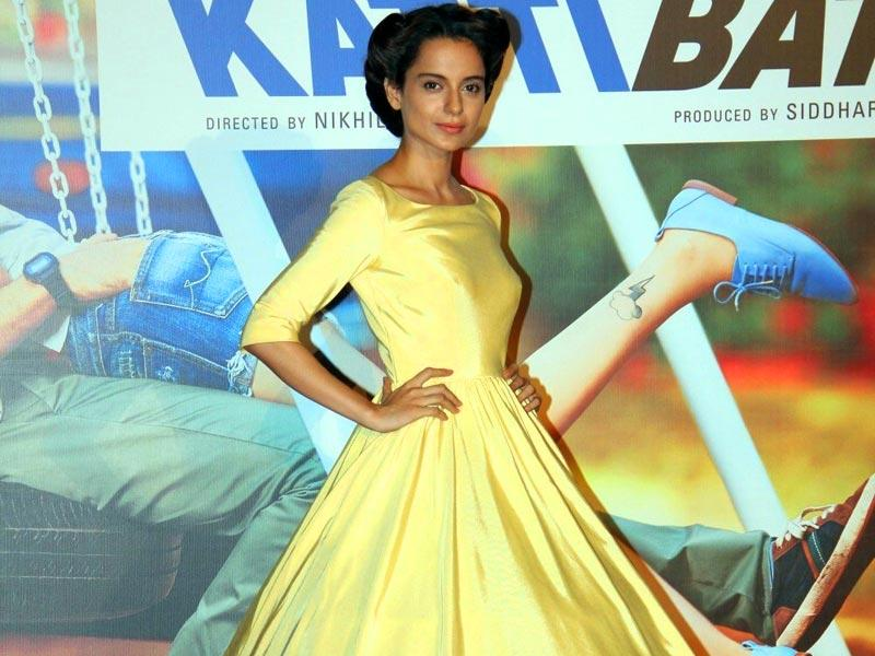 Dressed in a yellow taffeta dress, Kangana looked red-carpet ready at Katti Batti's trailer launch on Saturday. (IANS photo)