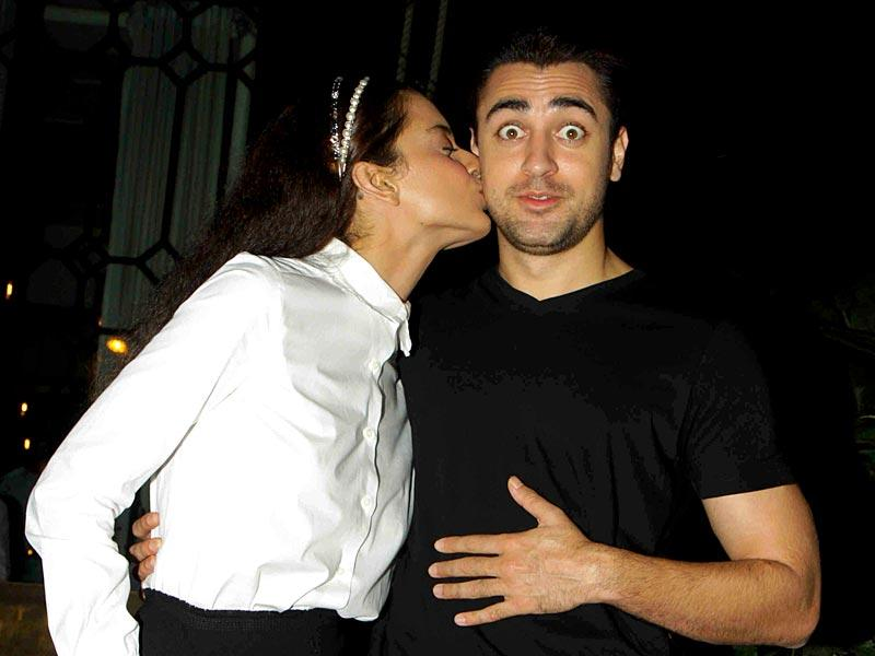 Kangana Ranaut seems not to be angry anymore and a surprised Imran gets a peck on the cheek. (AFP photo)