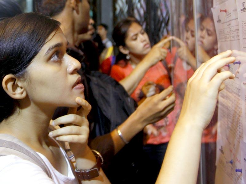 The first cut-off list for degree college admissions have been announced. Students look at the merit list at Dadar's Ruia College. (Kunal Patil/HT photo)