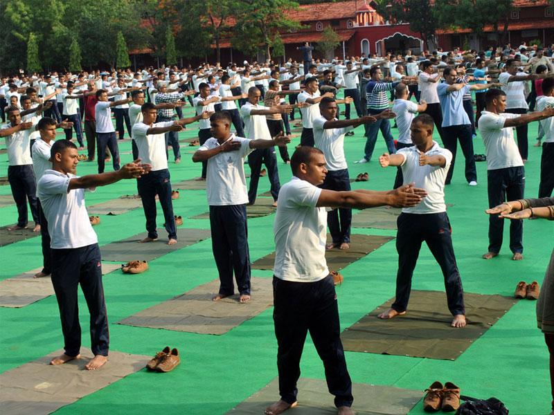 Administrative and police personnel rehearsing for International Day of Yoga at APTC ground in Indore on Thursday. (Arun Mondhe/HT photo)