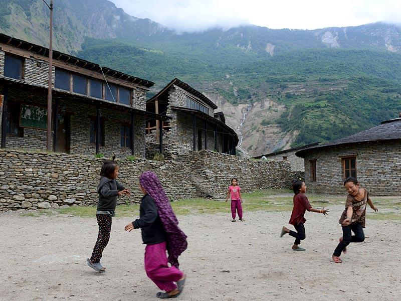 Nepalese children including Juna Gurung (R) as they play in the grounds of The Shree Buddha Secondary School in the village of Sirdibas in Gorkha District, some 250kms north-west of Kathmandu. (AFP photo)