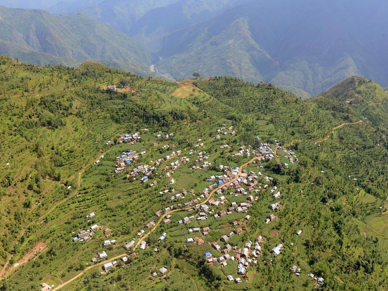 This photograph taken on June 14, 2015, shows an aerial view of zinc roofed dwellings of a village in the Gorkha District, some 250kms north-west of Kathmandu.(AFP photo)