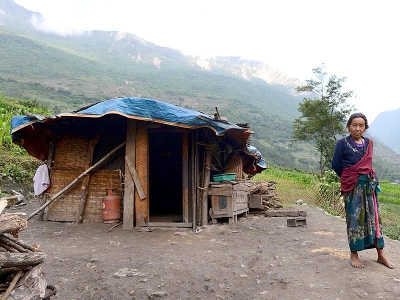 A Nepalese villager standing next to her temporary dwelling in the village of Sirdibas in Gorkha District. (AFP photo)