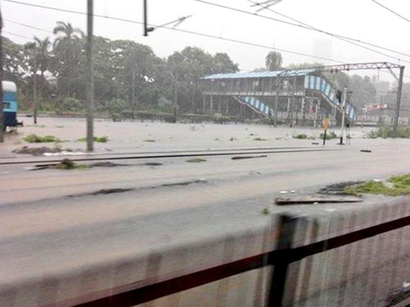 Waterlogged railway tracks have crippled the local trains in Mumbai (Photo by @kkordea01)