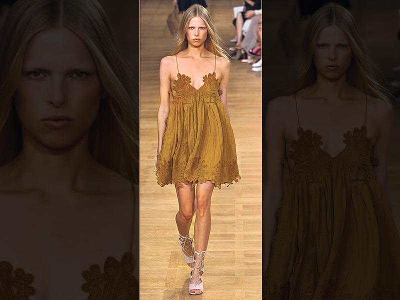 Dare to bare: Want to beat the heat? Rock a slip dress in a babydoll-esque length with dainty cut outs just like this mustard number by French fashion house Chloé. (AFP Photo)