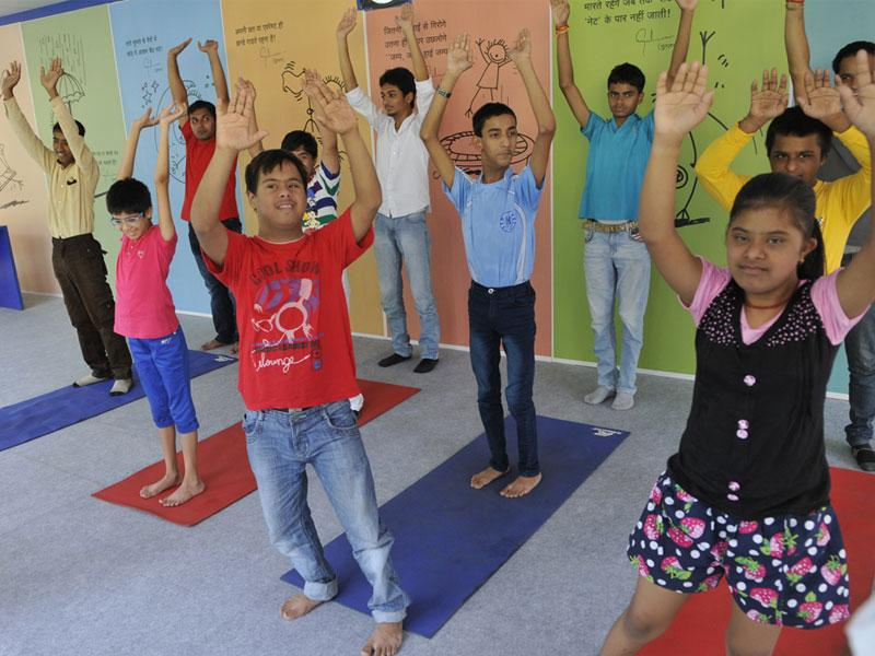 Differently-abled children of NGO Arushi perform yoga on the eve of International Day of Yoga, in Bhopal on Saturday. (Praveen Bajpai/HT)