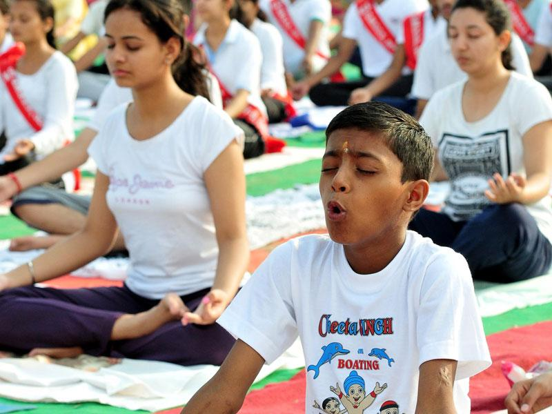 Students participating in International yoga day celebration at Exhibition Ground Sector 34 in Chandigarh on Sunday. (Keshav Singh/HT Photo)