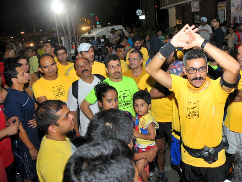 Participants during the night run that started from Aroma light point to Sukhna Lake in Chandigarh on Saturday. (Ravi Kumar/HT Photo)