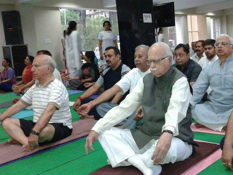 Senior BJP leader LK Advani takes part in a camp organised to mark International Yoga Day at Palampur on Sunday. Shyam Sharma/HT