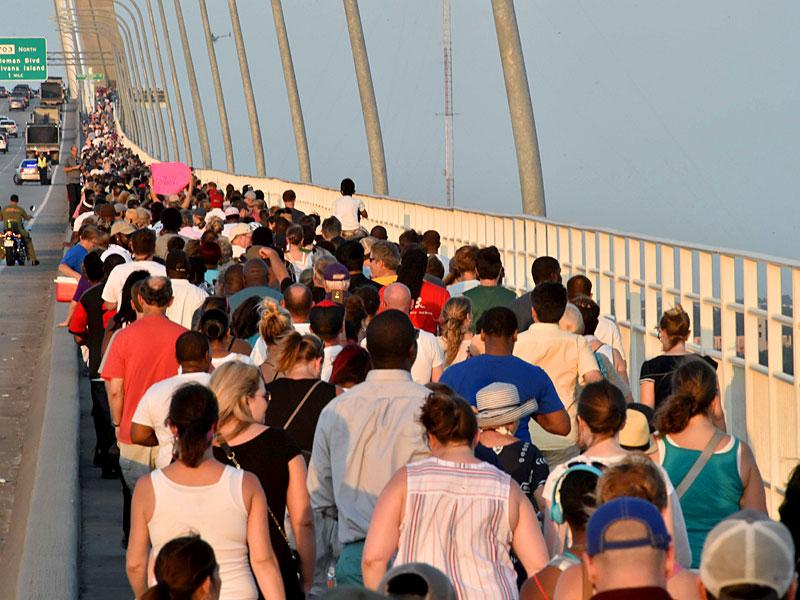 Thousands of people march on The Arthur Ravenel Jr. Bridge in Charleston, South Carolina (AFP Photo)